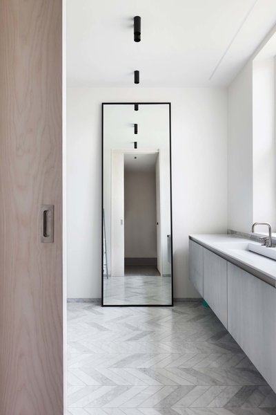 Modern home with bath room, engineered quartz counter, marble floor, undermount sink, and ceiling lighting. Photo 6 of Maida Vale Apartment
