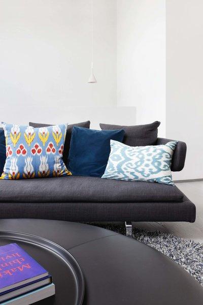 Modern home with living room, sofa, and pendant lighting. Photo  of Maida Vale Apartment