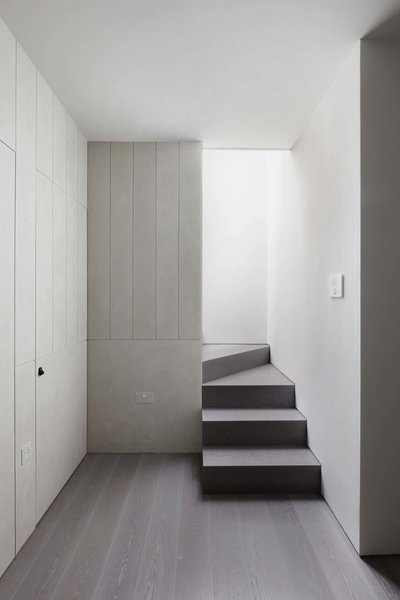 Modern home with staircase, wood tread, and wood railing. Photo 4 of Maida Vale Apartment