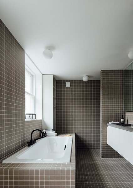 Modern home with bath room, drop in tub, and tile counter. Photo  of Stanhope Gardens