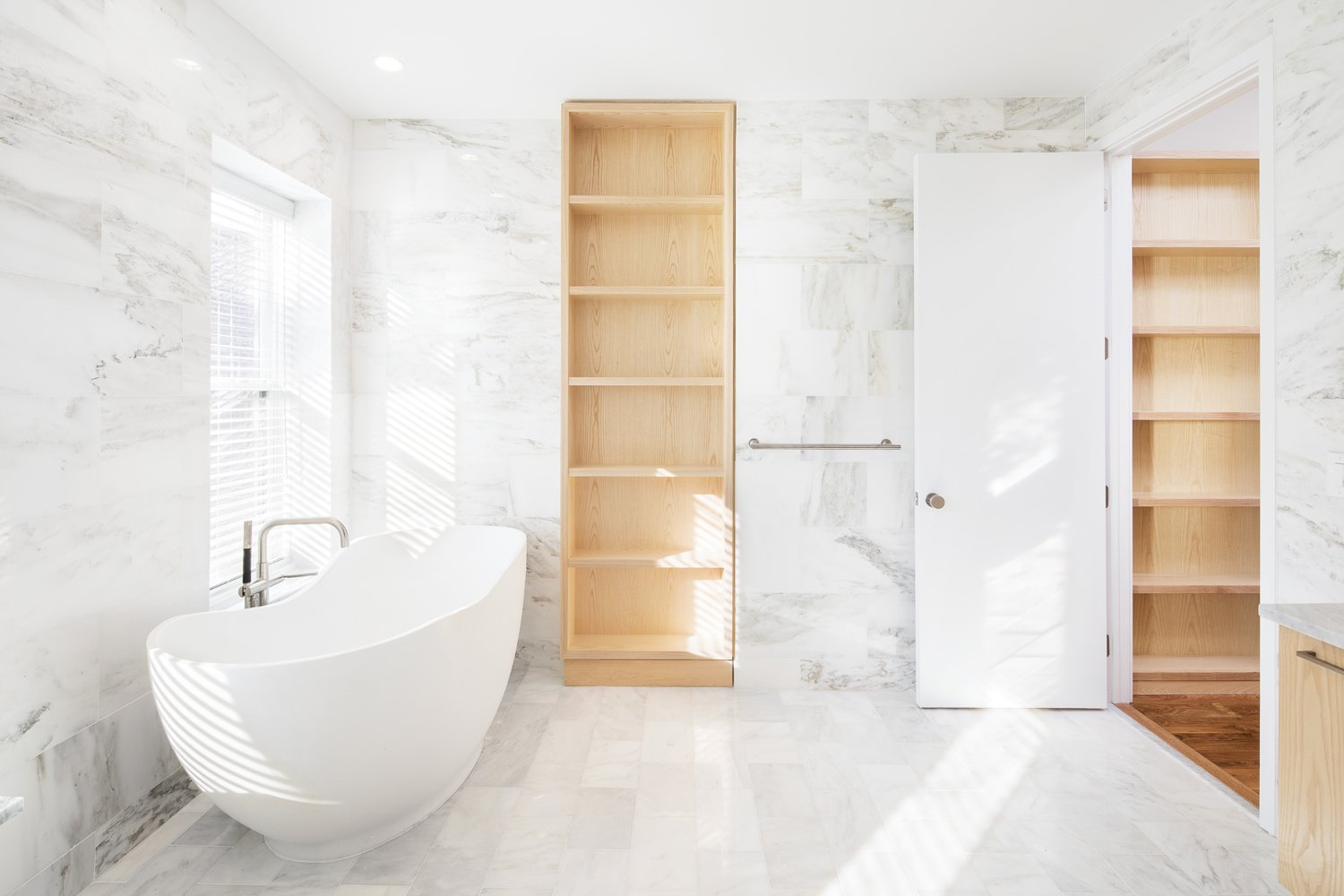 Tagged: Bath Room, Freestanding Tub, Marble Floor, and Marble Wall.  Wayne Street Row House by Leibal