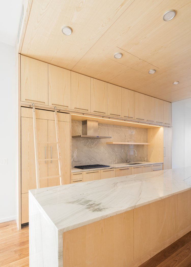Tagged: Kitchen, Wood Cabinet, Light Hardwood Floor, Marble Backsplashe, Marble Counter, Recessed Lighting, Range, Range Hood, and Undermount Sink.  Wayne Street Row House by Leibal