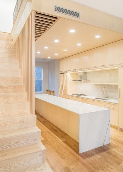 Modern home with kitchen, medium hardwood floor, marble counter, recessed lighting, and marble backsplashe. Photo 8 of Wayne Street Row House
