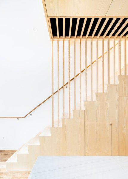 Modern home with staircase, wood tread, and wood railing. Photo 7 of Wayne Street Row House