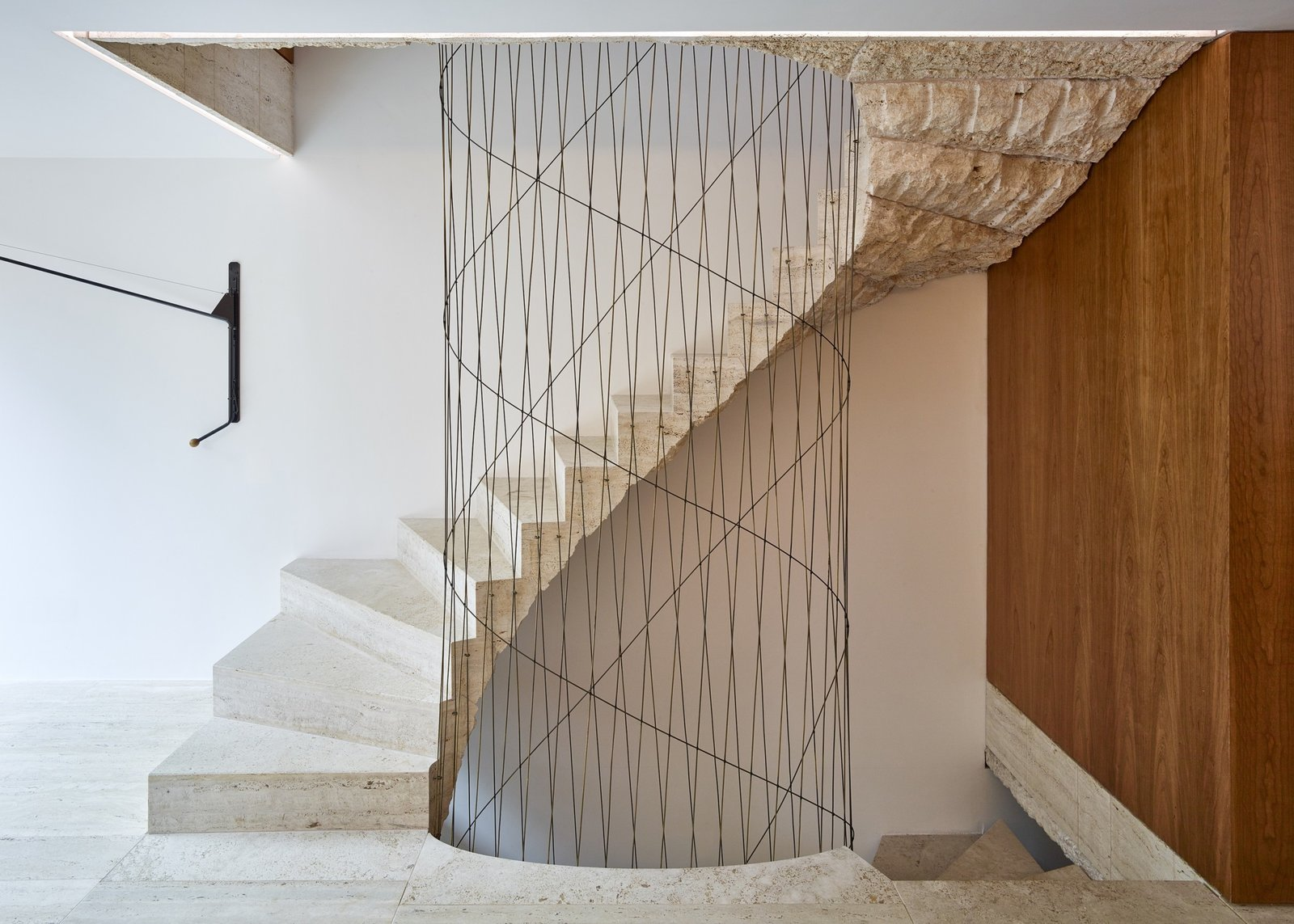 Tagged: Staircase, Stone Tread, and Metal Railing. Caroline Place by Leibal
