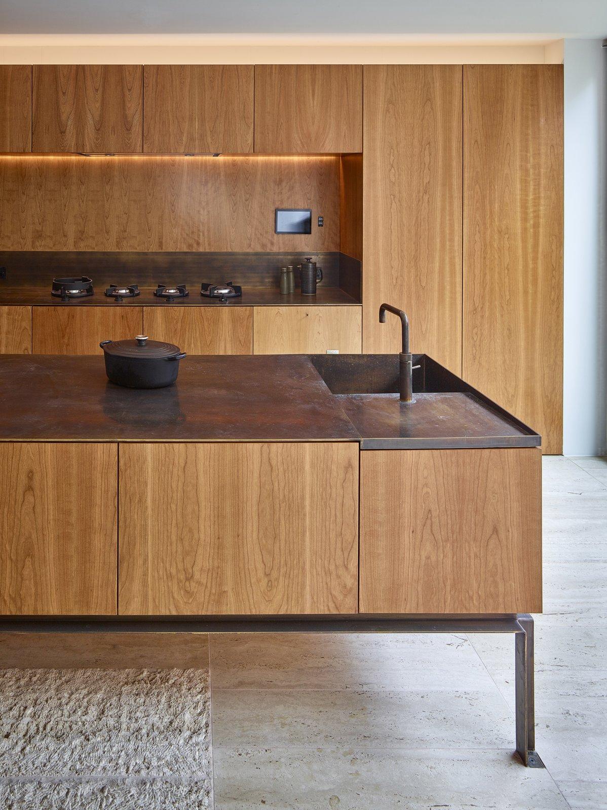 Tagged: Kitchen, Wood Cabinet, Wood Counter, Wood Backsplashe, Concrete Floor, Range, and Undermount Sink. Caroline Place by Leibal