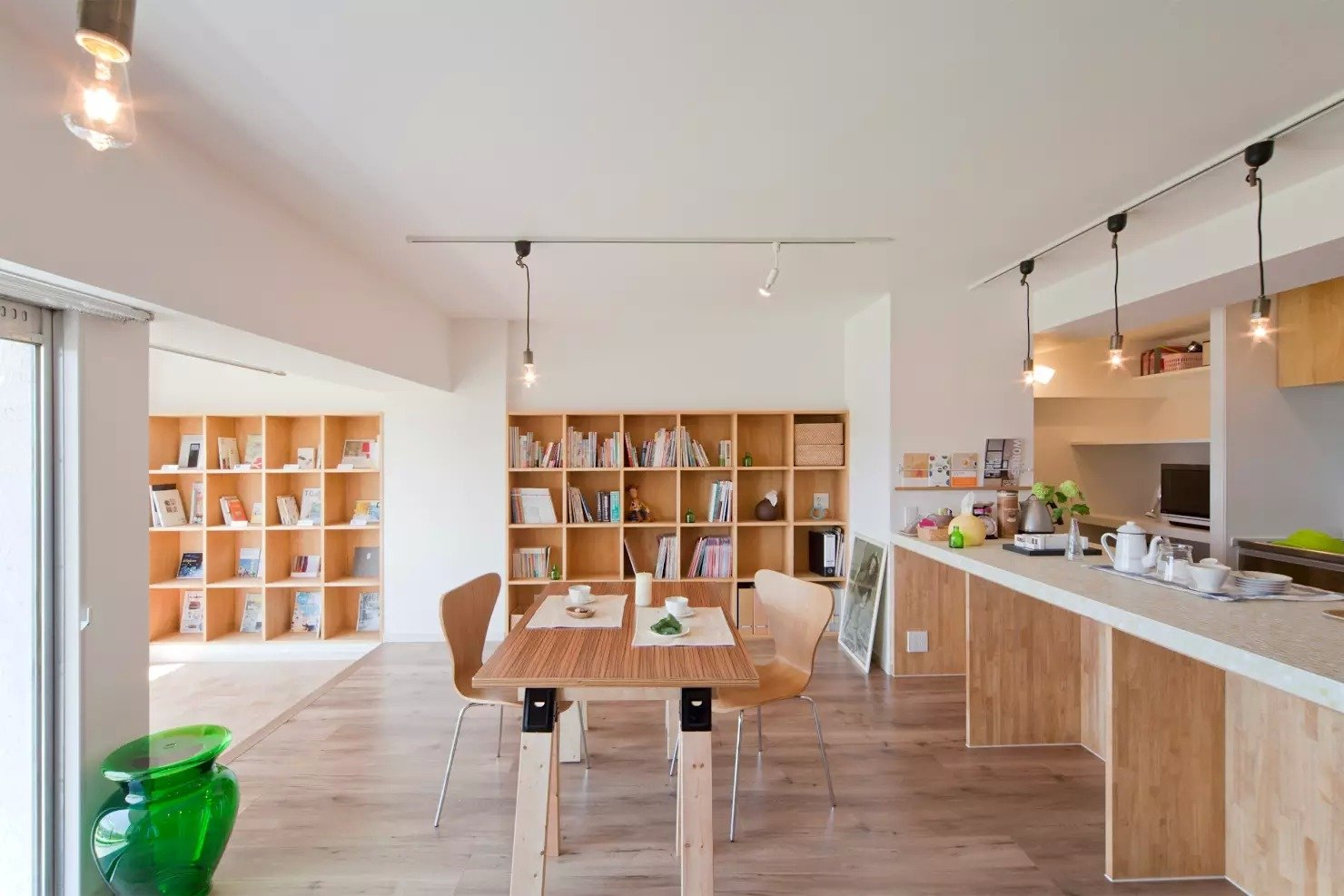 Tagged: Living Room, Chair, Track Lighting, Medium Hardwood Floor, and Bookcase. Book Cafe House by Leibal