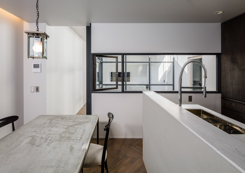 Tagged: Kitchen, Marble Counter, Medium Hardwood Floor, Pendant Lighting, and Undermount Sink.  Residence in Takariya by Leibal