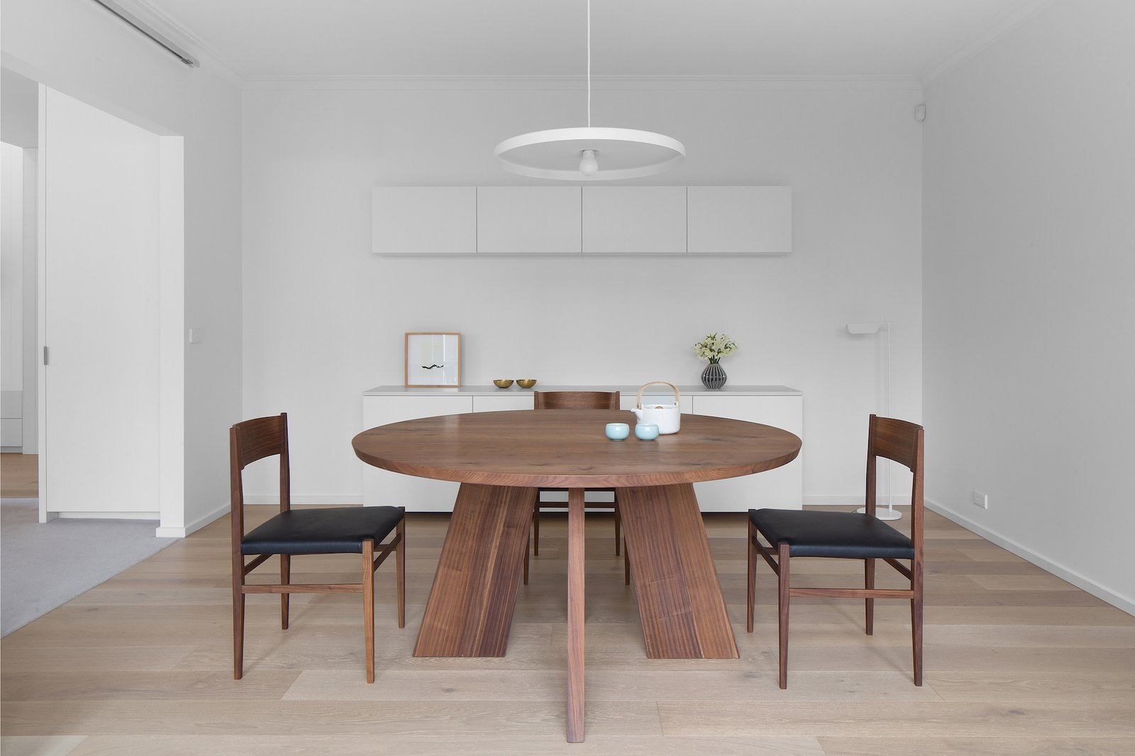 Tagged: Dining Room, Chair, Table, Pendant Lighting, and Light Hardwood Floor.  Corhampton Rd Residence by Leibal