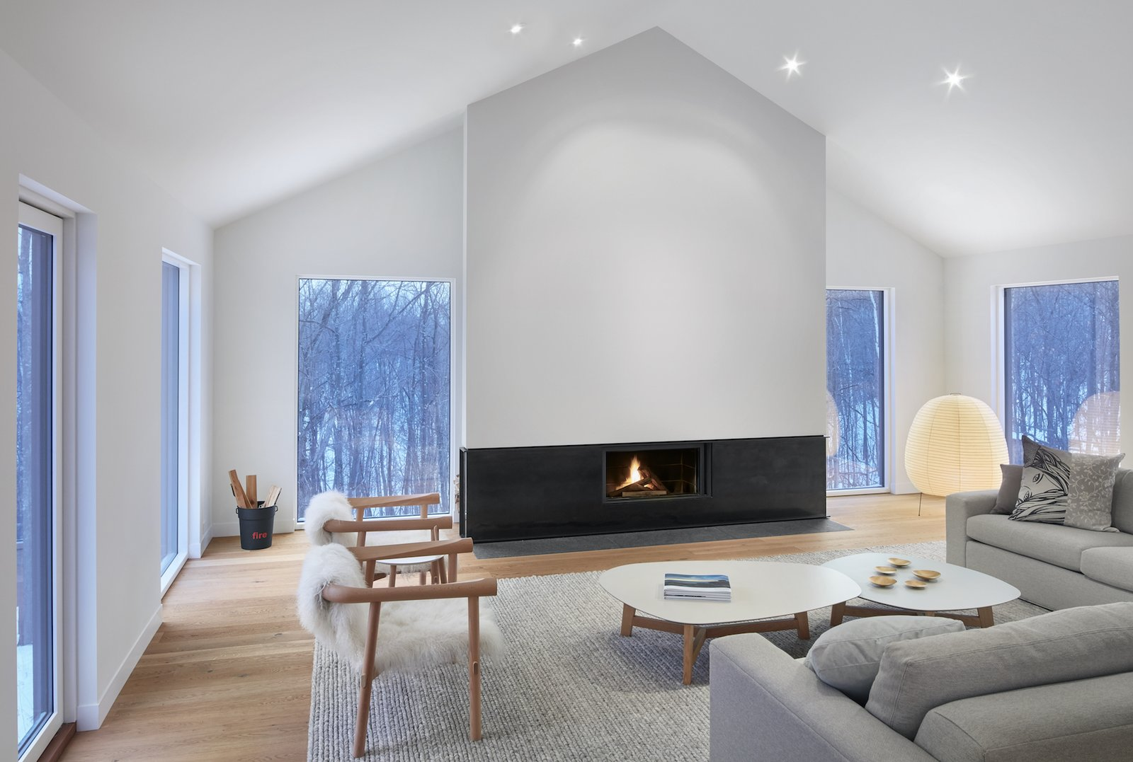 Tagged: Living Room, Standard Layout Fireplace, Light Hardwood Floor, Chair, and Recessed Lighting.  Alta Chalet by Leibal