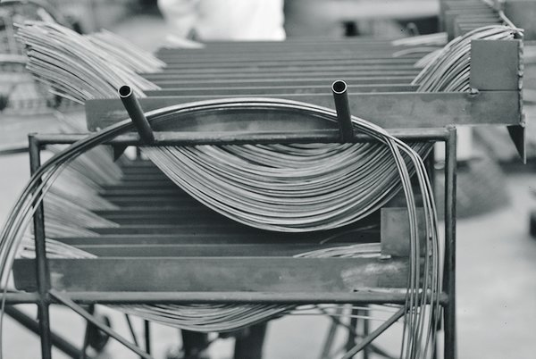 Making Bertoia - Photo 2 of 14 - The stainless steel metal rods used in the assembly of the Bertoia Collection. Image from the Knoll Archive.