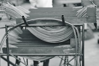 The stainless steel metal rods used in the assembly of the Bertoia Collection. Image from the Knoll Archive.