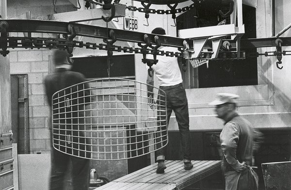 Making Bertoia - Photo 11 of 14 - Finished Bertoia Ottoman being transported through the factory for assembly. Image from the Knoll Archive.