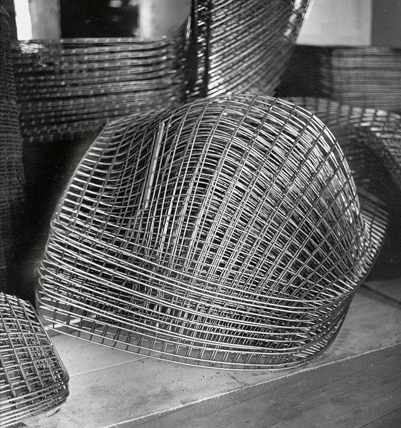 Making Bertoia - Photo 12 of 14 - Finished Bertoia Diamond Chair frames stacked and awaiting assembly. Image from the Knoll Archive.
