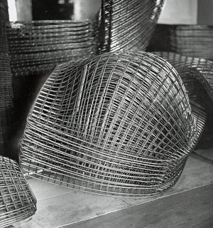 Finished Bertoia Diamond Chair frames stacked and awaiting assembly. Image from the Knoll Archive.