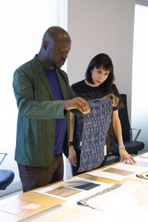 Knoll Inspiration: In Conversation with David Adjaye - Photo 3 of 6 - David Adjaye with Dorothy Cosonas reviewing Dakar drapery from The Adjaye Collection for KnollTextiles. Photography by KnollTextiles.