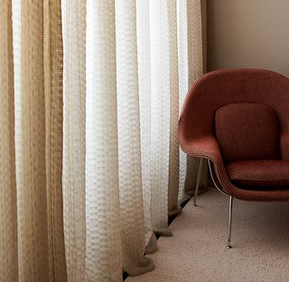 Knoll Inspiration: In Conversation with David Adjaye - Photo 4 of 6 - Kampala-upholstered Womb Chair with Dakar drapery. Photography by KnollTextiles.
