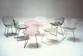 Knoll Inspiration: Reintroducing the Bertoia Two-Tone - Photo 4 of 6 - Bertoia Side Chairs shown in green, blue, white, red, white, yellow, black and chrome colorways. Image from the Knoll Archive.