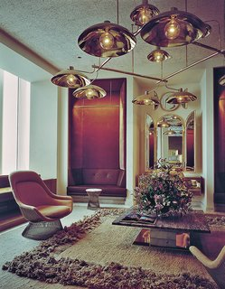 Knoll Inspiration: Introducing Platner Gold - Photo 3 of 6 - The Windows on the World reception room, designed by Warren Platner in 1976, included a Platner Easy Chair and Platner Side Table. Photograph courtesy of the Nestlé Library.