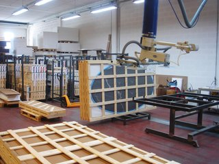Finished marble tops being crated and prepared for shipment.