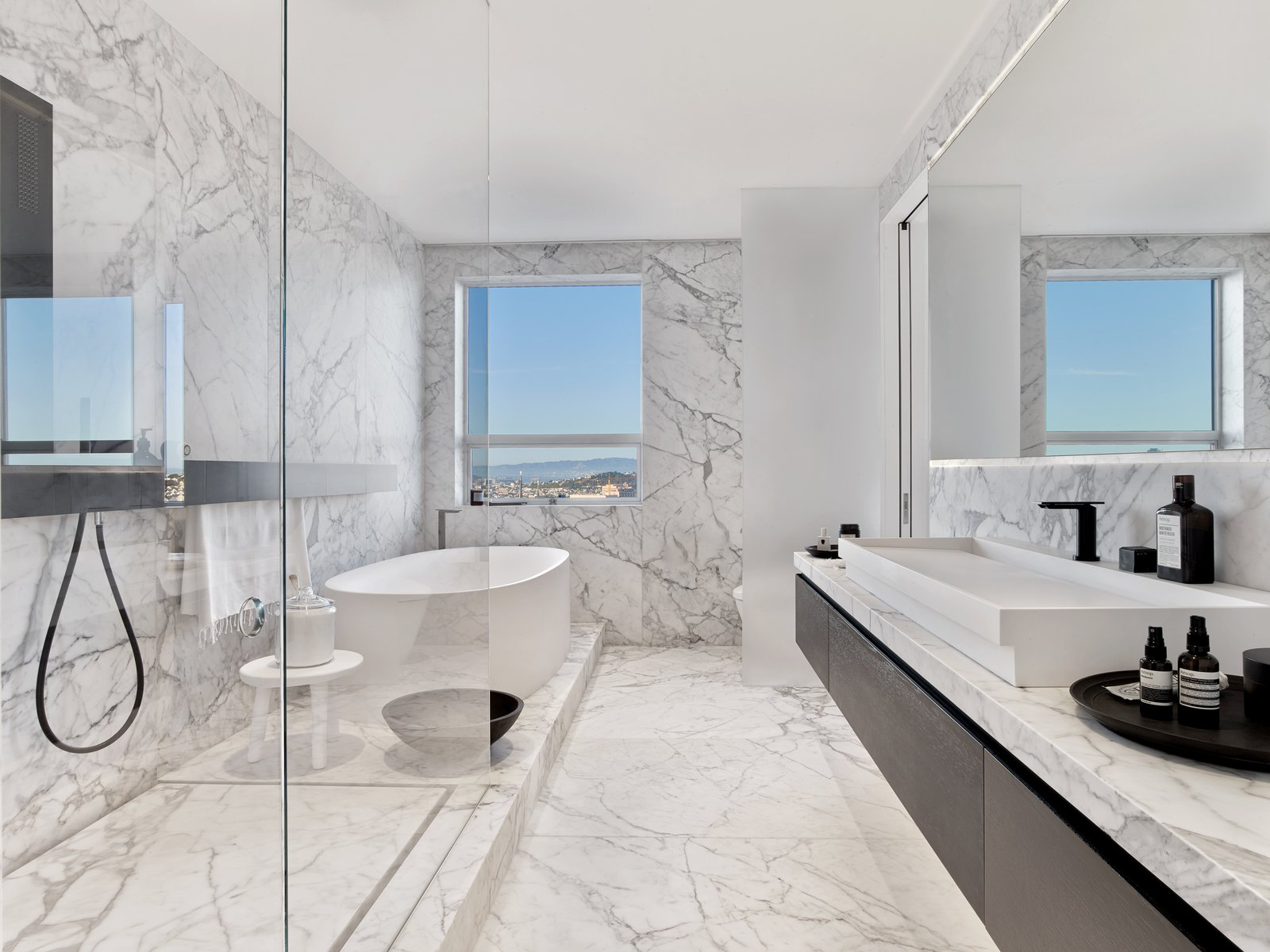 Master bath Tagged: Bath Room, Marble Floor, Vessel Sink, Freestanding Tub, Marble Counter, Soaking Tub, Enclosed Shower, Corner Shower, and Marble Wall.  Glen Park Residence by CCS Architecture