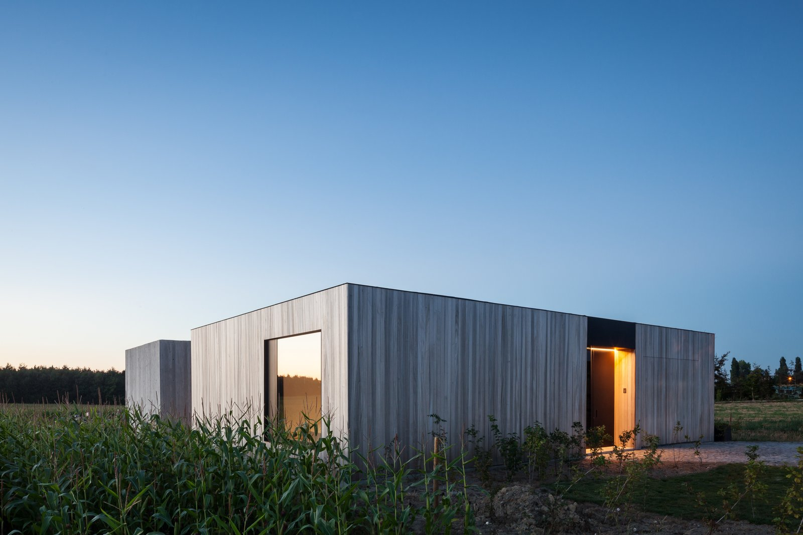 Tagged: Exterior, House, Wood Siding Material, and Flat RoofLine.  Photo 13 of 14 in Defying traditionalism: concrete bungalow inserted in a rural Belgian landscape