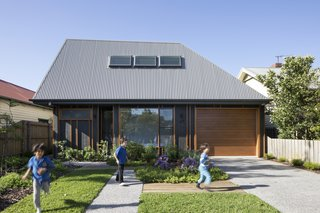 "A Family Home in Australia Features a Playful Version of the Classic Pitched Roof - Photo 1 of 9 - Porjazoski thought that reinterpreting a traditional pitched roof in a highly angled form would set the home apart from its neighbors. The roof is made from Colorbond Custom Orb in ""Wallaby."""