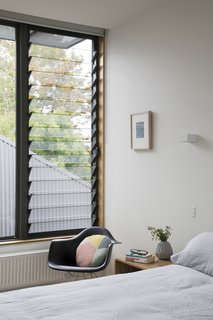 "A Family Home in Australia Features a Playful Version of the Classic Pitched Roof - Photo 8 of 9 - A Breezway Louver window brings fresh air into a bedroom. ""Despite their modest size, all spaces feel expansive, thanks to the constant presence of generous windows,"" Porjazoski says."