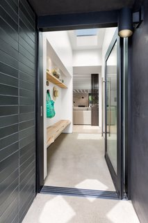 """The Woman Who Grew Up in This L.A. Home Returned to Give it a Stunning Renovation - Photo 2 of 11 - Benjamin Moore's """"Swiss Coffee"""" was used in the entryway, which features a custom bench and shelf made of unfinished oak by Anderson Plywood."""