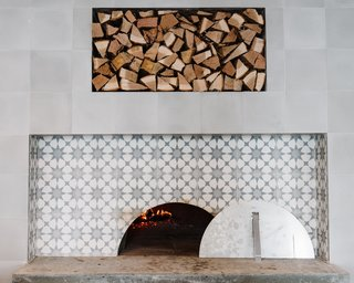 A Women-Run Restaurant in Nashville Invites Visitors to Just Have Fun - Photo 5 of 6 - The six-foot wood-burning oven features the same sunburst tile as the floors.