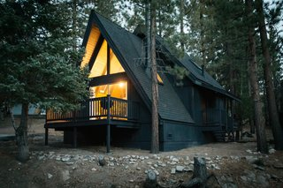 """A 1970s A-Frame Cabin in Big Bear Is Brought Back to Life - Photo 2 of 12 - """"It was built in 1973,"""" Poulos says. The property is minutes from the slopes and village that make Big Bear such a popular vacation spot."""