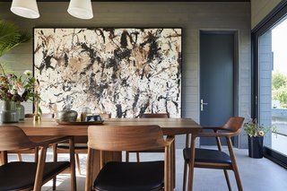 This Modern Farmhouse Outside Toronto Makes Its Own Rules - Photo 4 of 11 - Interior design firm & Daughters built the dining table, and the Hiroshima upholstered dining chairs are by Naoto Fukasawa from Mjölk. Harouna Ouedraogo artwork hangs on the wall.