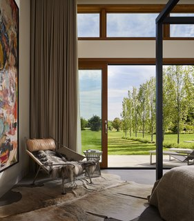 This Modern Farmhouse Outside Toronto Makes Its Own Rules - Photo 7 of 11 - Harouna Ouedraogo artwork, the same artist shown in the dining room, is also showcased in the master bedroom.