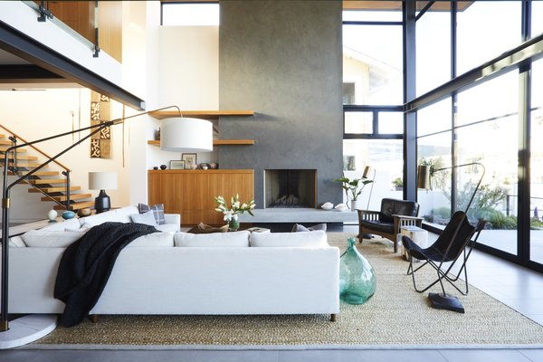A cream-colored Mitchell Gold + Bob Williams sectional designates the living area in this open concept, as does a Kochi Pattern rug from the Taj Collection at Area Rug Factory.