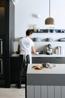 """Calling All Food52 Fans: The Brand's New Annex Is Its Best Look Yet - Photo 1 of 5 - """"The wood paneling that surrounds the island is identical to the paneling on the eighth floor test kitchen backsplash,"""" Sherman says, but this time, it's in darker shades."""