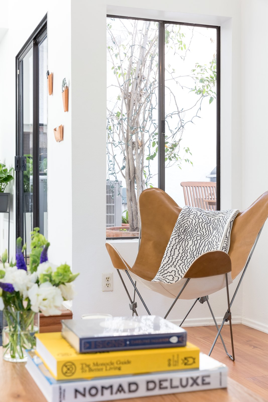 The butterfly chair in the living room was sourced from Urban Outfitters.