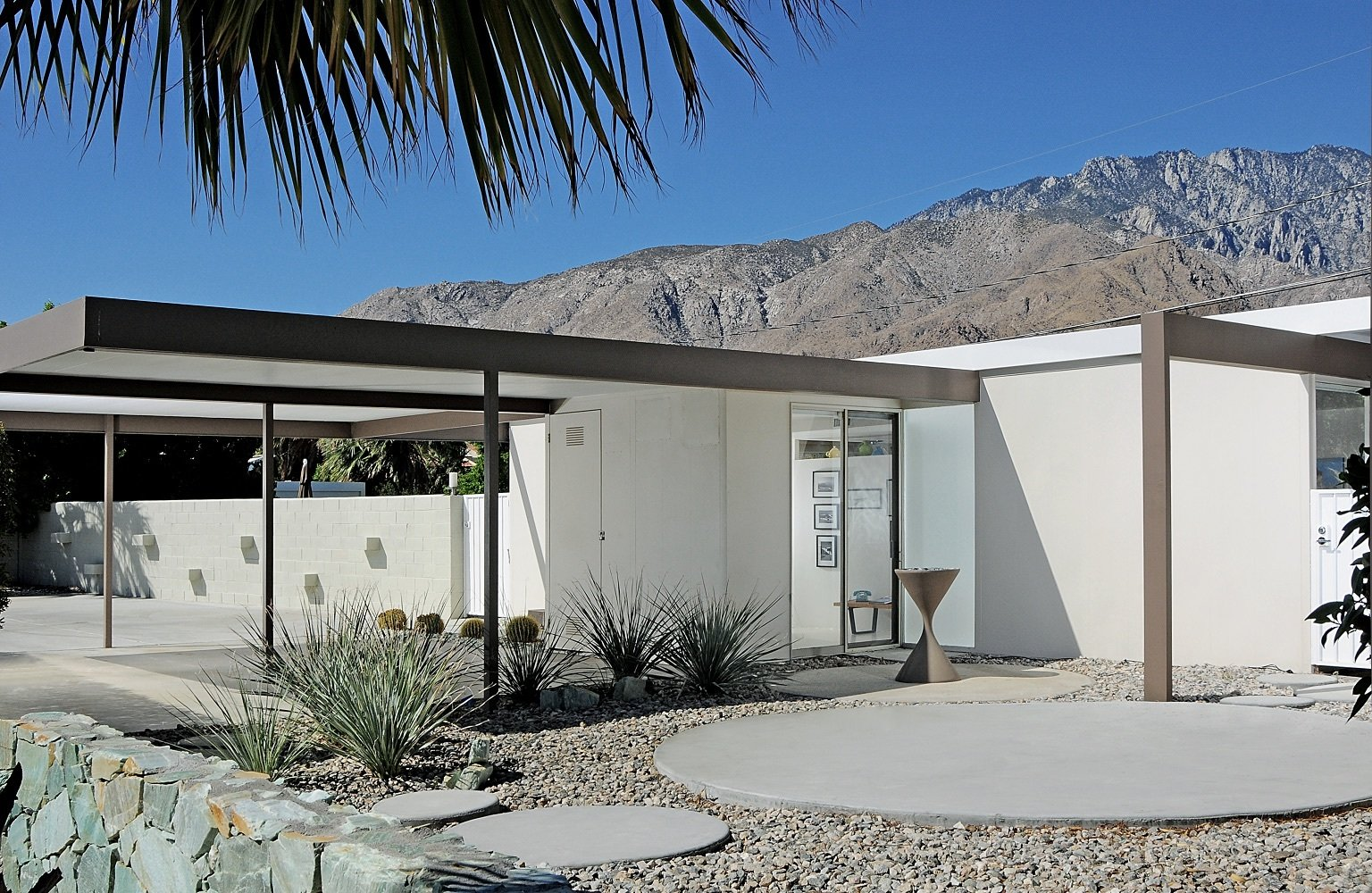 The two-bedroom, two-bathroom house has a pool and an open air carport on a fourth-acre lot.