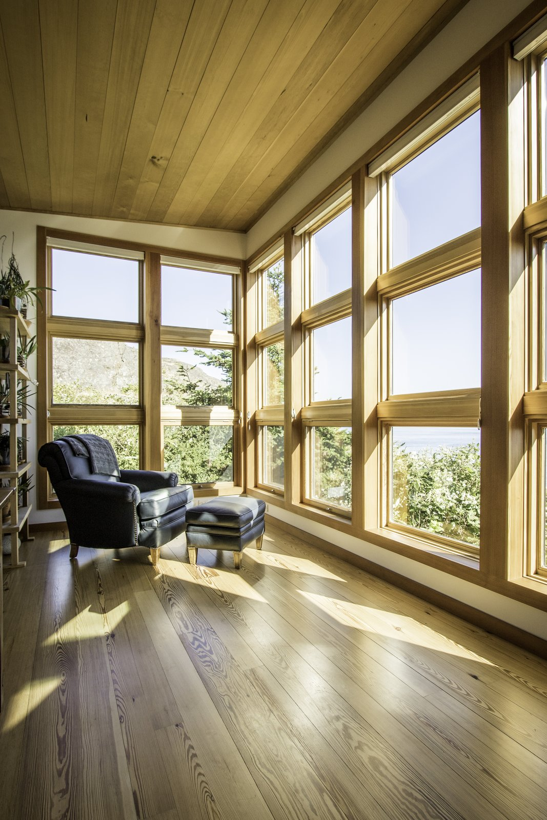 The sunny, view-focused living room encourages a life of quiet reflection.  Eagle Point by Prentiss + Balance + Wickline Architects