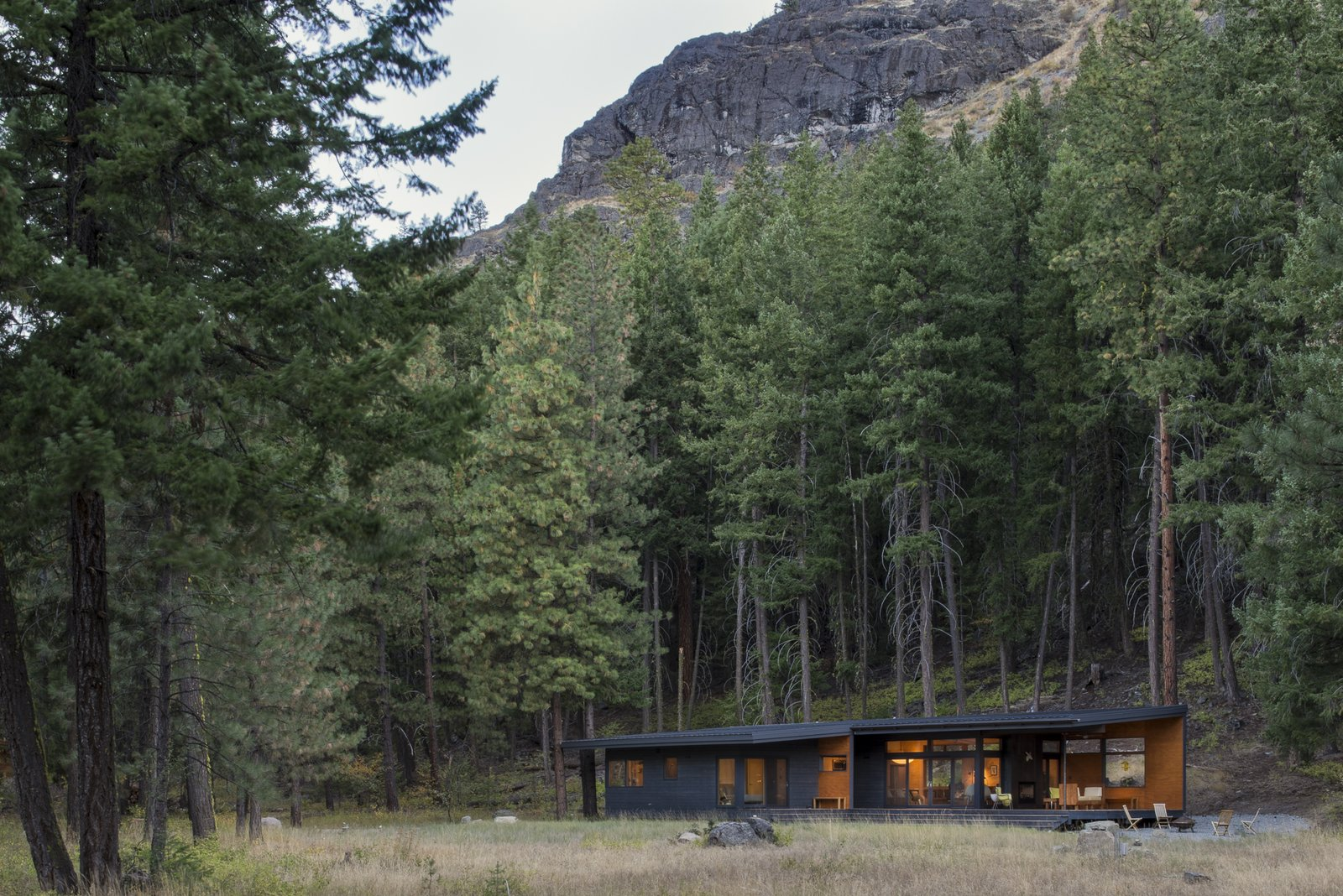 Nestled into the surrounding forest against a dramatic backdrop.  Lot 6 by Prentiss + Balance + Wickline Architects