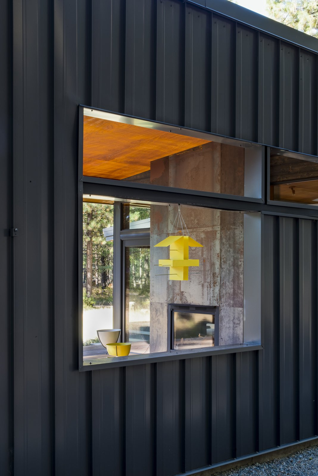 """A peek into the """"outdoor room"""" with double-sided fireplace. Lot 6 by Prentiss + Balance + Wickline Architects"""