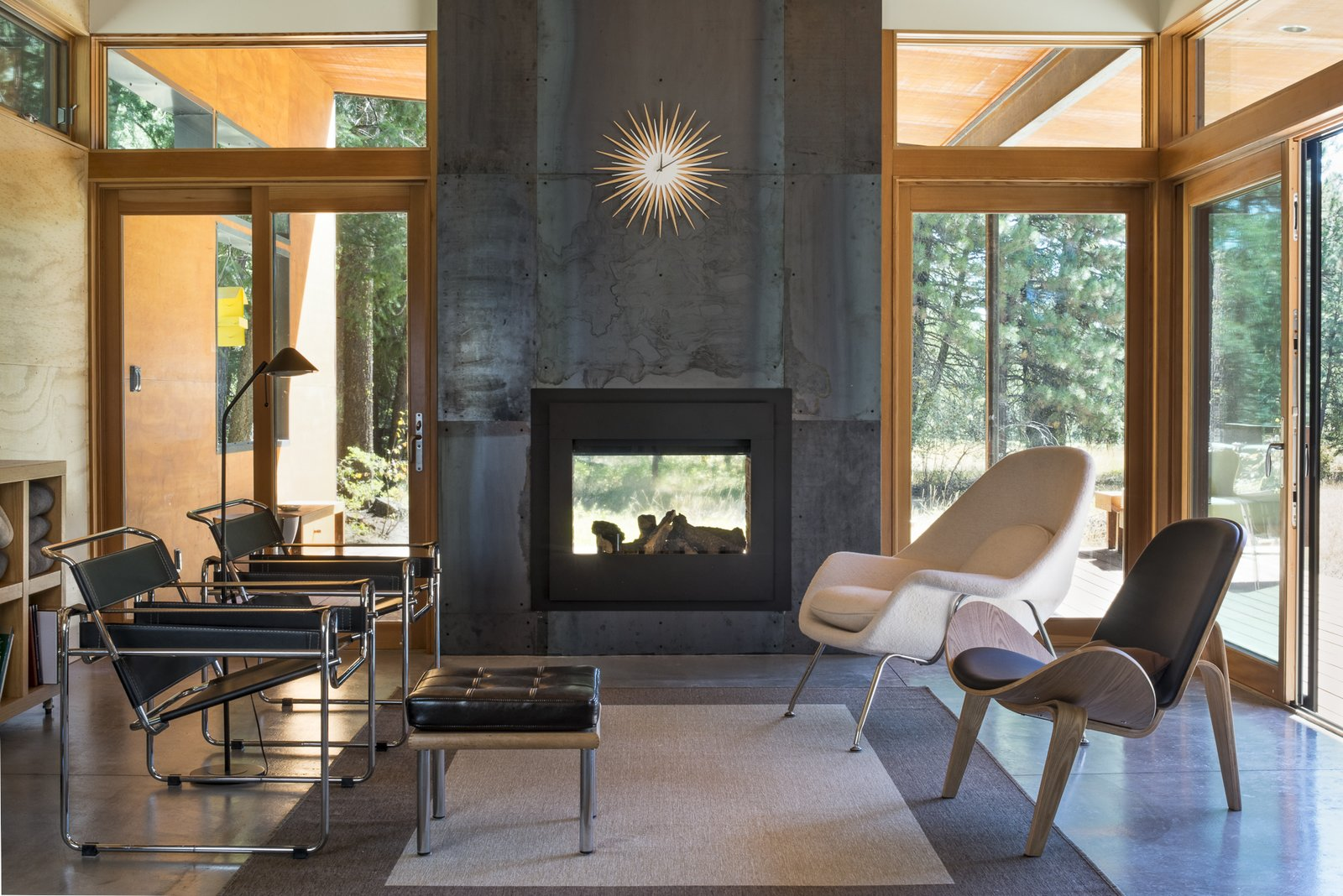 The interior living room, on the reverse of the double-sided fireplace.  Lot 6 by Prentiss + Balance + Wickline Architects