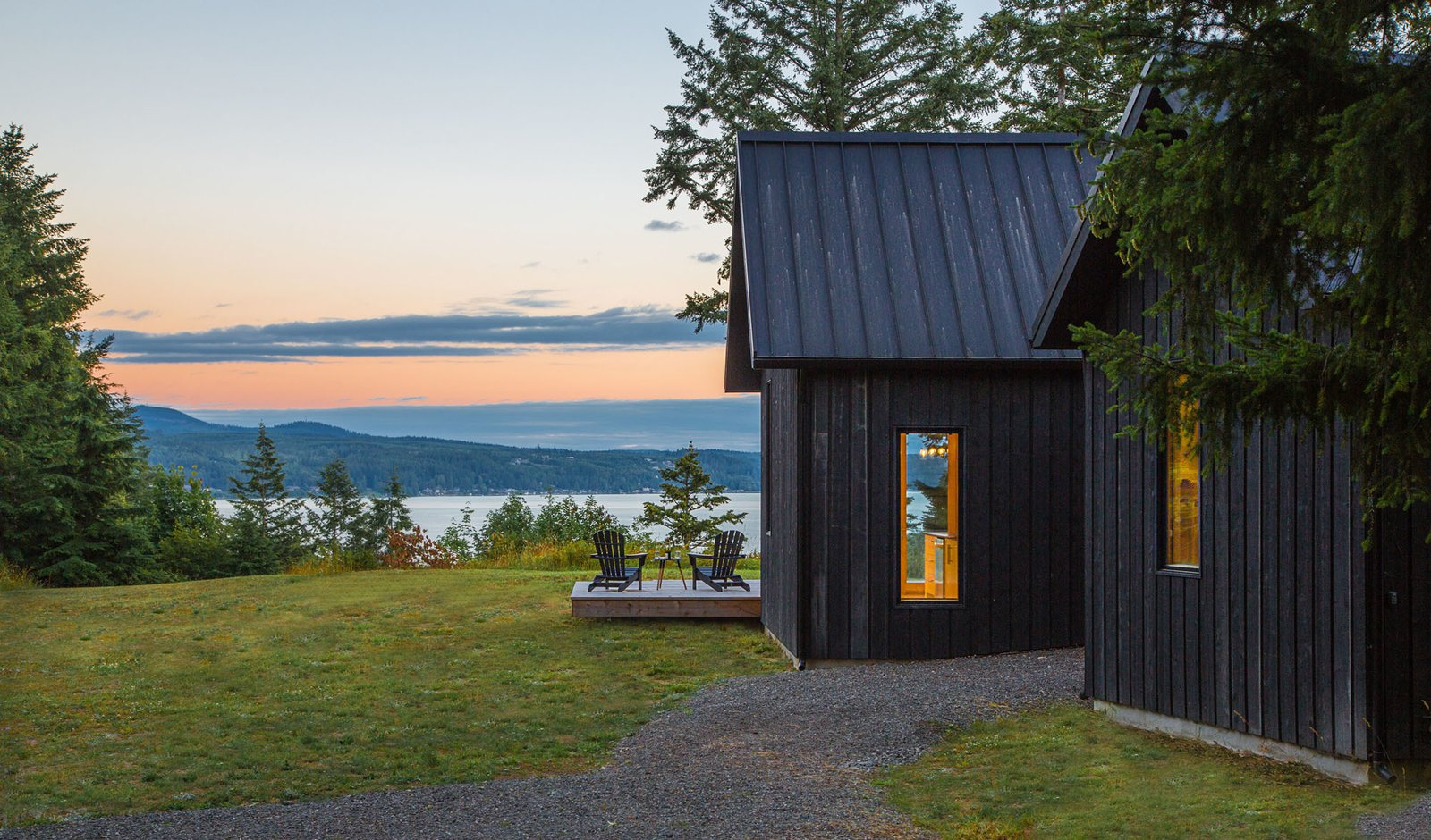 Quiet, dark volumes emphasize the natural beauty and views of Hood Canal. Tagged: Outdoor.  The Coyle by Prentiss + Balance + Wickline Architects