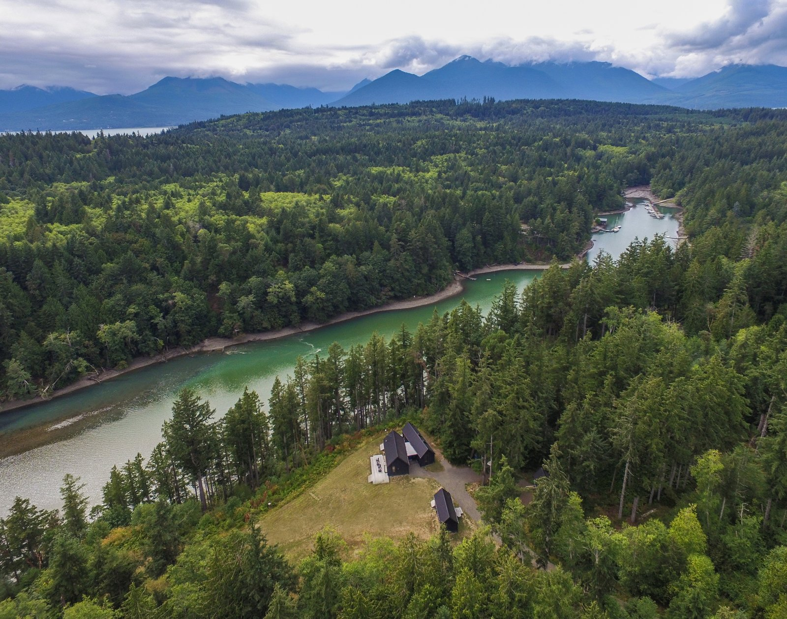 An existing meadow provided an ideal location for the three structures. Set high above the water, the clearing is surrounded by a dense forest of Douglas fir.
