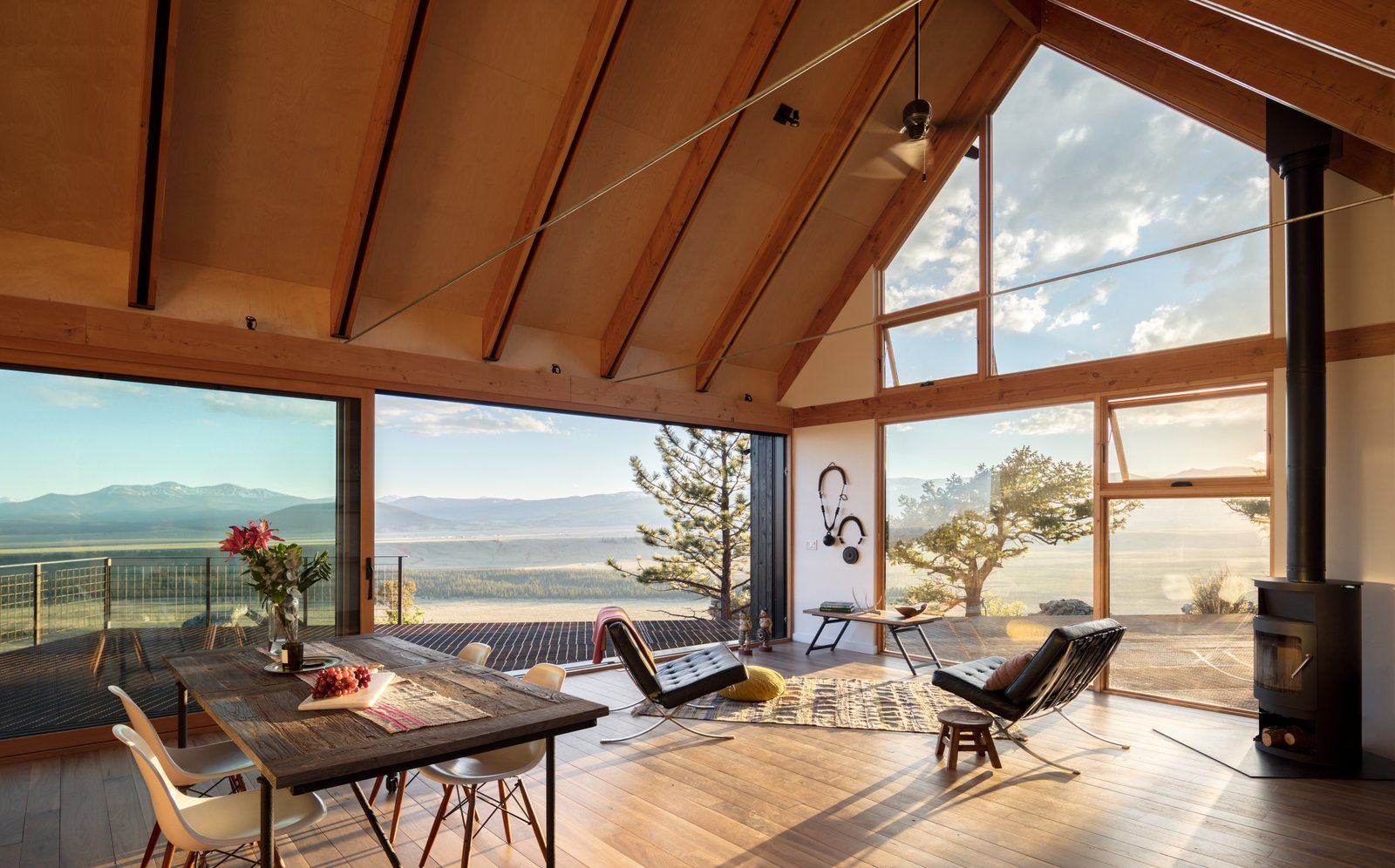 Tagged: Living Room, Wood Burning Fireplace, Table, Chair, and Medium Hardwood Floor.  Big Cabin | Little Cabin by Renée del Gaudio Architecture