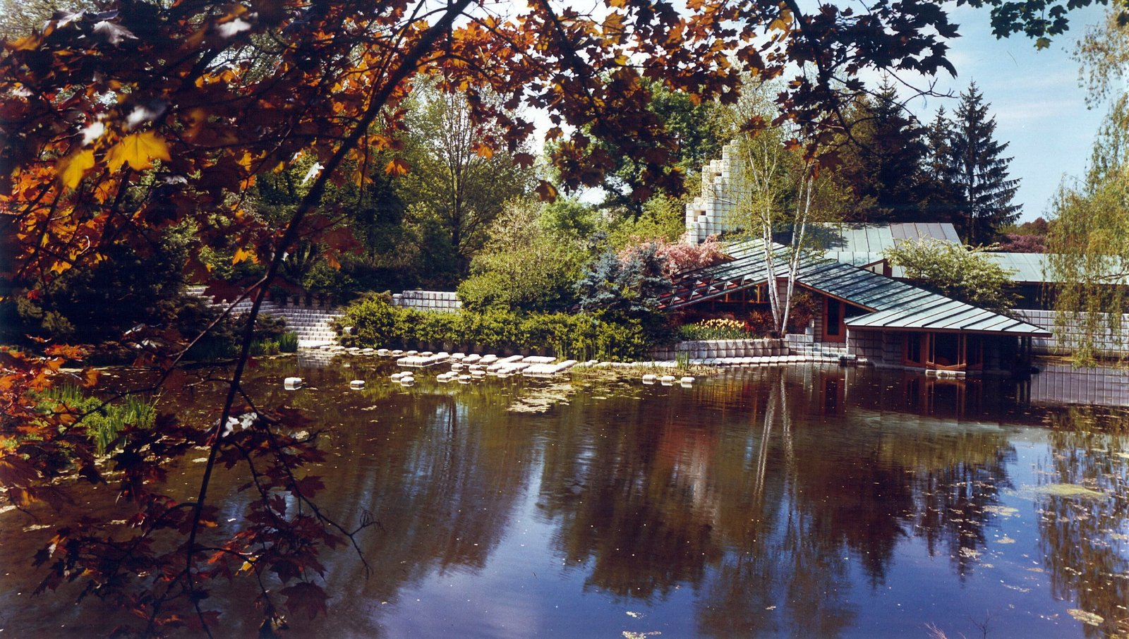 """The Alden B. Dow Home and Studio in Midland features a sunken parlor that is level with an expansive pond. The Japanese-style landscaping embodies Dow's philosophy that """"gardens never end and buildings never begin.""""  Photo 3 of 5 in Defining an Architectural Canon From the Ground Up"""