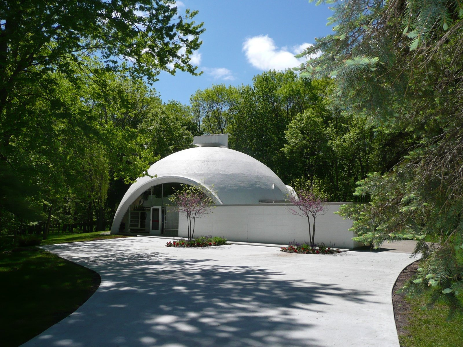 The Robert E. Schwartz House, designed by Robert Schwartz and nestled in Northwest Midland, features a dramatic concrete and styrofoam dome constructed with Dow Chemical technology.