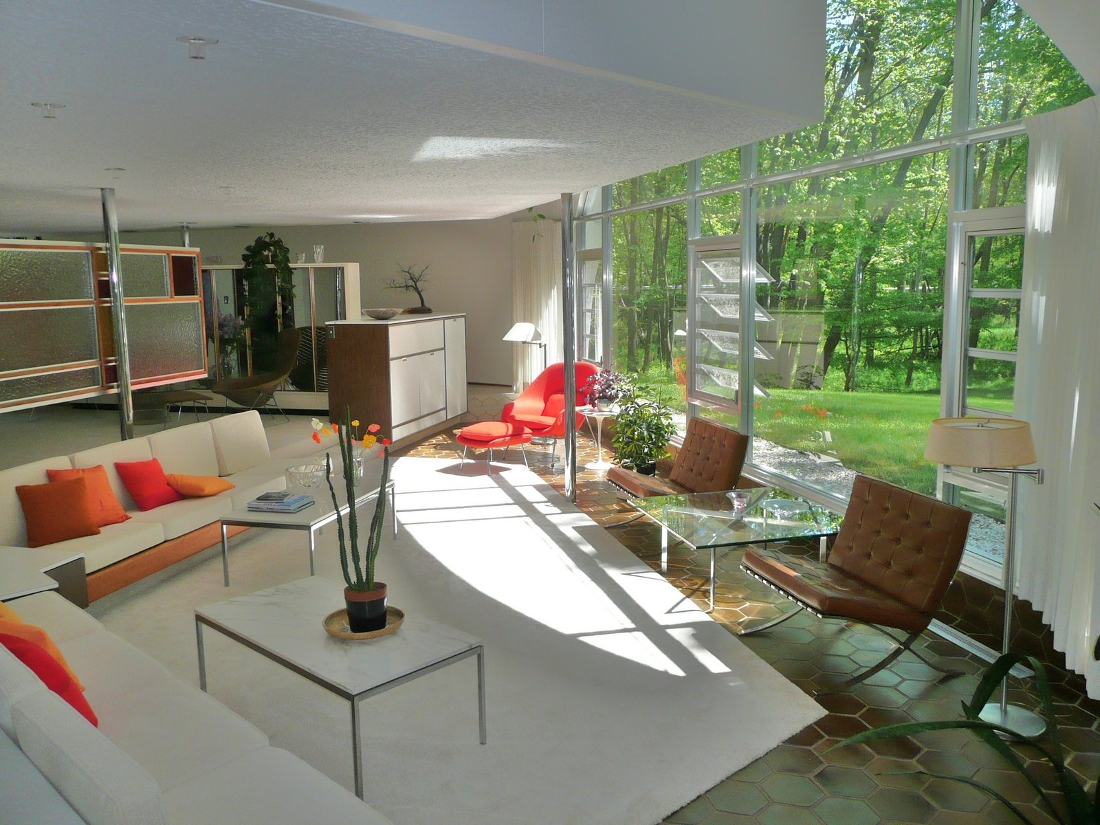 Robert Schwartz's Schwartz House has a quintessentially midcentury modern interior complete with sunken living room, open floor plan and iconic midcentury furniture.  Photo 5 of 5 in Defining an Architectural Canon From the Ground Up