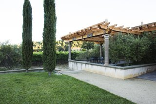 A Northern California Winery's Breathtaking Vistas Are Enhanced by Natural Redwood - Photo 1 of 5 - The larger pergola is outside of the winery's main tasting room, and provides a cool outdoor space for patrons.