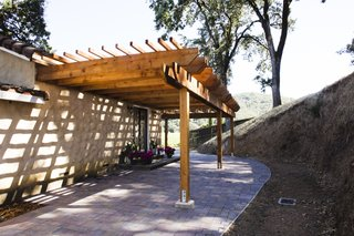 A Northern California Winery's Breathtaking Vistas Are Enhanced by Natural Redwood - Photo 2 of 5 - The second pergola shades the entryway to one guest casita, extending the private outdoor living space.