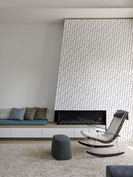 The angled fireplace is clad in Grove Brickworks field tile from Waterworks – laid vertically with no grout in between.